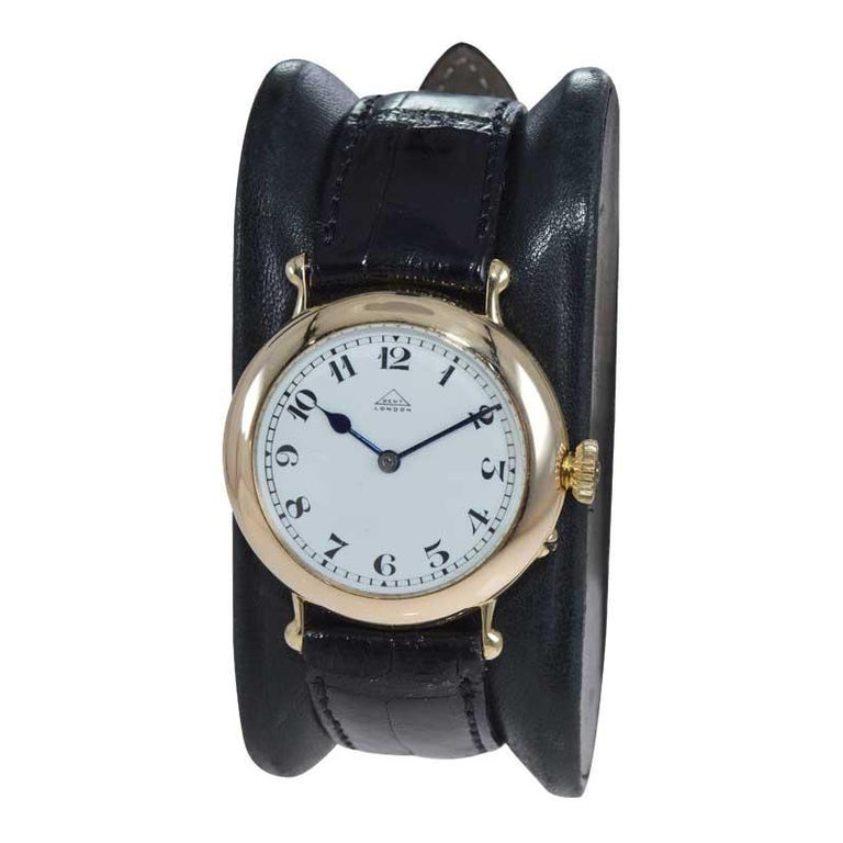 FACTORY / HOUSE: Dent of London STYLE / REFERENCE: Military Style METAL / MATERIAL: 18kt Yellow Gold CIRCA / YEAR: 1926 DIMENSIONS / SIZE: 31mm x 36mm MOVEMENT / CALIBER: Manual Winding / 15 Jewels / Cal.10L DIAL / HANDS: Original Kiln Fired Enamel