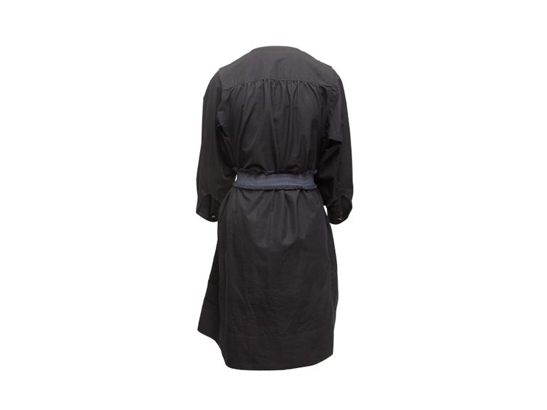 Product details: Navy cotton long sleeve dress by Derek Lam. Crew neck. Belt at waist. 32