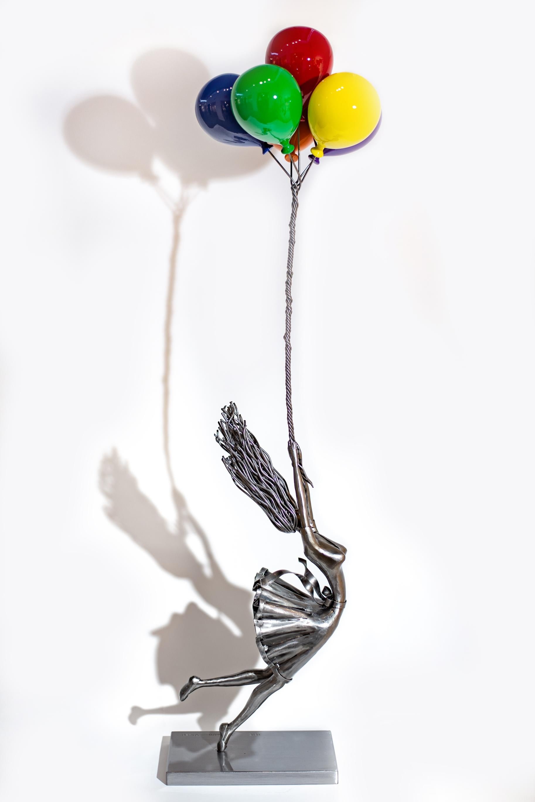 Soar Beyond Your Fears - girl holding vividly coloured balloons