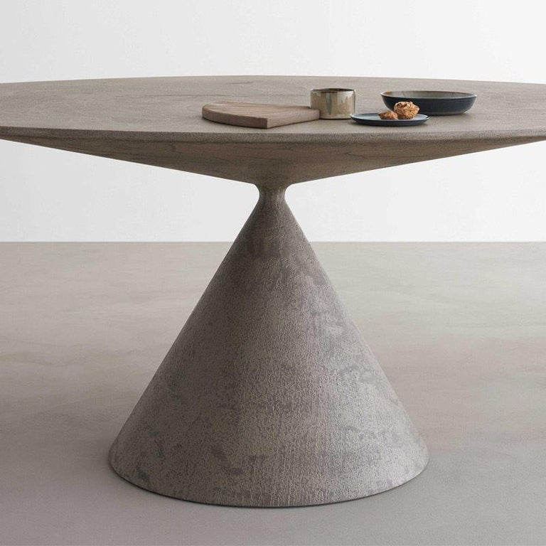 Clay indoor oval table 218 x 120 D65 CEMENTO GRIGIO Luna More than a table, a sculpture, a perfect union of beauty and harmonious proportions. Presented at the 2015 Milan Furniture Fair and winner of different awards: Iconic Design Award 2015,