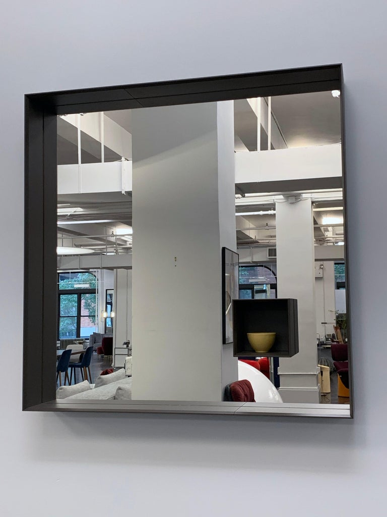 Mir mirror Measures: 90 x 90 cm Frame finish: Marrone Bungee (Bungee Brown) clove compartment marrone bungee Designed by Marco Acerbis • 2017 A formal frame: this is a mirror which combines a visual aspect, created by the balance between the