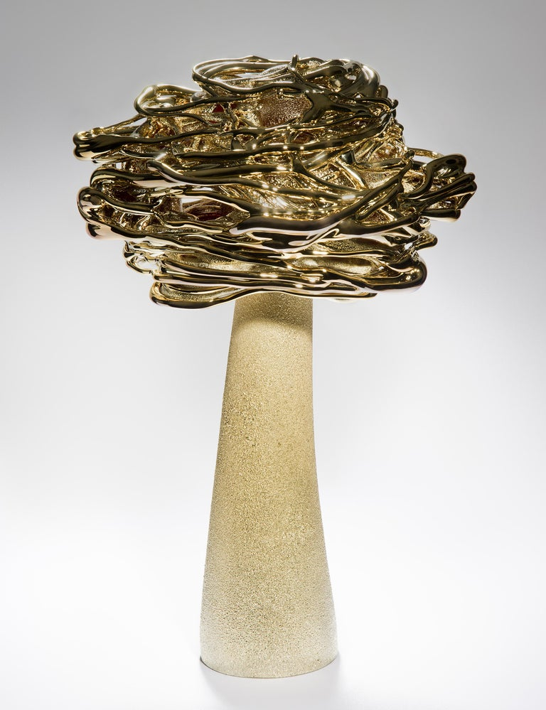 Desert Flower, is a unique brass and glass sculpture by the Lithuanian artist Remigijus Kriukas. Blown and hot sculpted to create this substantial artwork, the final piece is finished with a fine coating of brass.  In 1985 Remigijus Kriukas