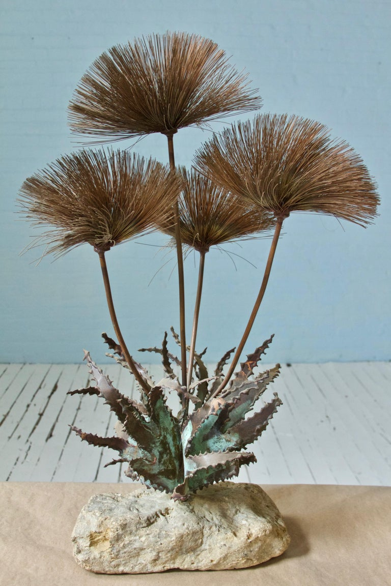 Decorative Jere-style Brutalist desert flowers made of metal brass or copper, mounted to a solid stone base. Sculpture attributed to artist John Steck.
