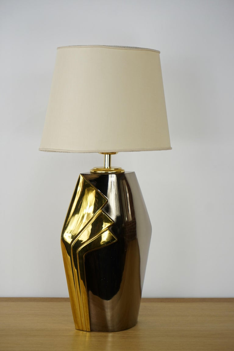 Design metal and brass lamp with harmonious and precious lines. Prestigious and elegant