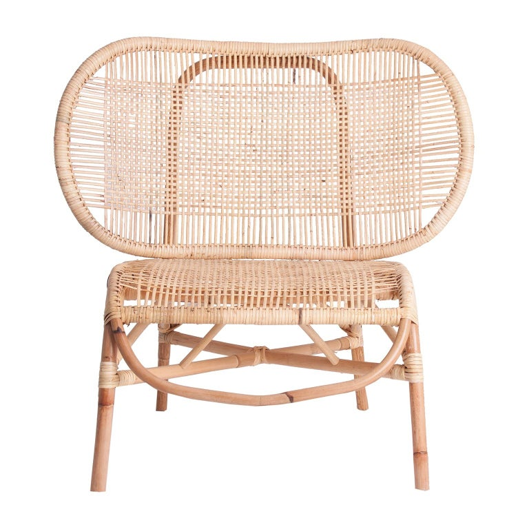 Design and original lounge armchair with cane and natural rattan airy structure.