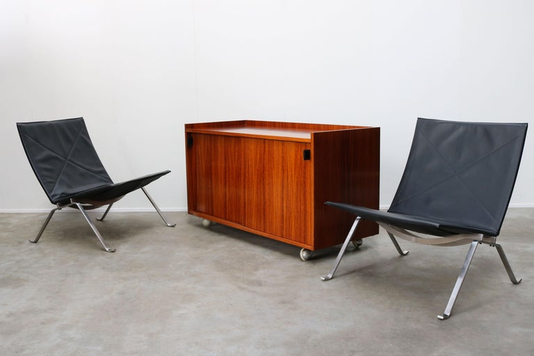 Vintage design credenza / sideboard in rosewood with leather grips designed by Florence Knoll for De Coene Belgium in the 1960s. Wonderful clean Minimalist modernist design in rosewood , the piece is covered in rosewood on all sides and can be used