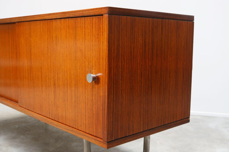 Minimalist modernist design sideboard / credenza by Belgian designer Alfred Hendrickx for Belform. This is a very rare small model of his Office series and looks amazing on the chrome feet. The sideboard has 2 sliding doors with aluminum grips and