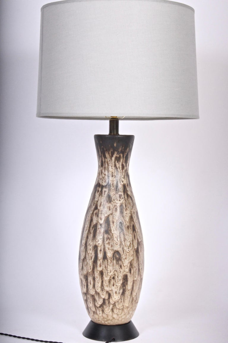 Substantial Lee Rosen for design-technics glazed geologic art pottery table lamp. Small footprint.  Classic fDT orm, handcrafted with sculptured drip glaze in neutral tones featuring deep brown to top. 24 H to top of socket. 20 H to top of ceramic.