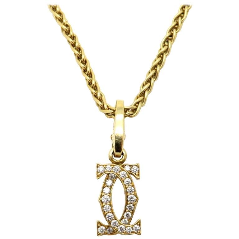 80876941cf0ff Designer 18 Karat Yellow Gold Double C Cartier Charm Necklace