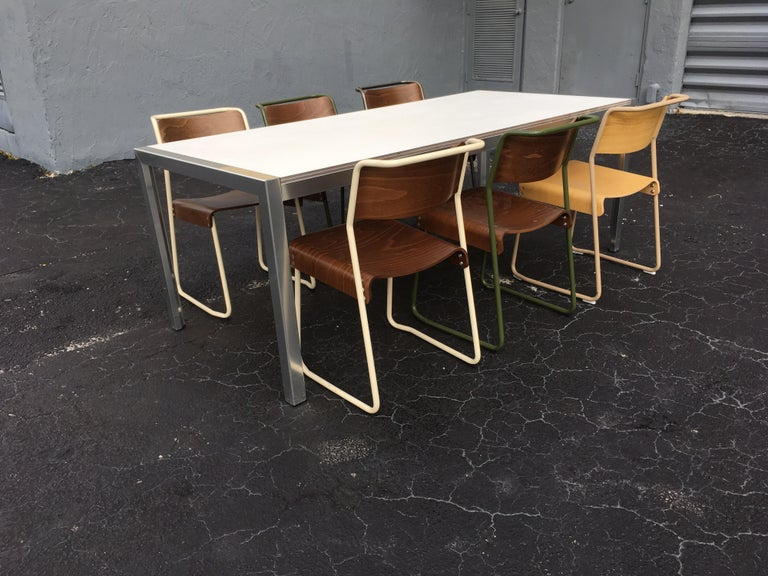 Aluminum table with a white top. Great quality. Designer piece.
