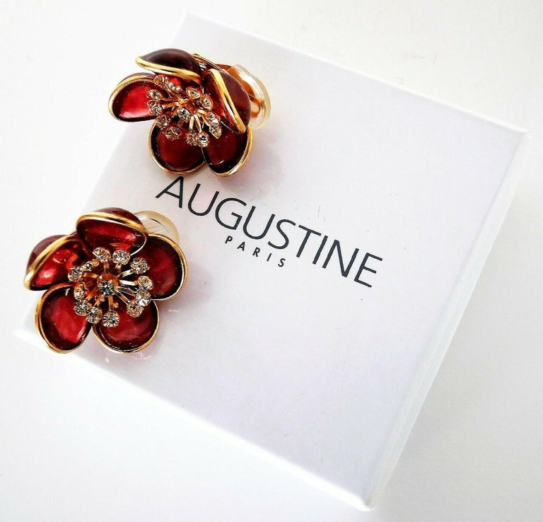 Simply Fabulous Clip on Flower Earrings designed by AUGUSTINE Paris and produced by Thierry Gripoix. Featuring Gripoix glass Flower petals in translucent Pink, center of each flower prong set with small clear Crystals. Gold-plated mounting. Approx.