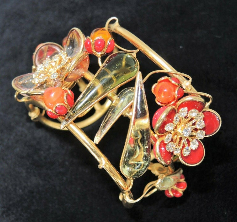 Simply Fabulous Cuff Bracelet designed by AUGUSTINE Paris and produced by Thierry Gripoix. Featuring Gripoix glass flowers, petals, buds and leaves in translucent light lilac, light green, milky-orange and brown-red. Center of the flowers prong set