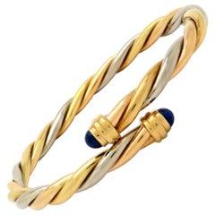 Designer Cartier 18 Karat Gold Lapis Lazuli Twisted Bypass Cuff Bangle Bracelet