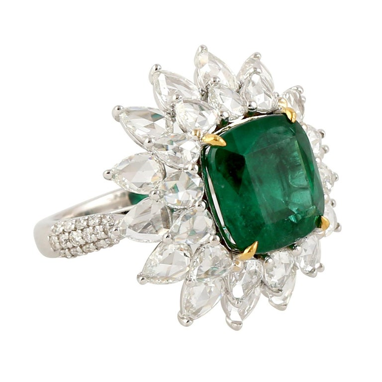 This designer Emerald and White Diamond Ring in 18K white Gold is one of the gorgeous ring we have and is full of charm and uniqueness.  Ring Size: 7 ( Can be sized )  18KT: 6.572gms Diamond: 4.27cts Emerald: 4.72cts