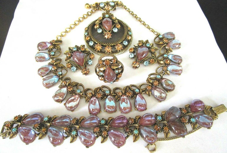 Fabulous Florenza Signed Grande Parure, 4 piece set, includes Necklace, Bracelet, Brooch, clip Earrings and adjustable Ring.  Hand set with Amazing teardrop Saphiret Stones, blue and Topaz Rhinestones and golden leaves. Necklace measures 16.5