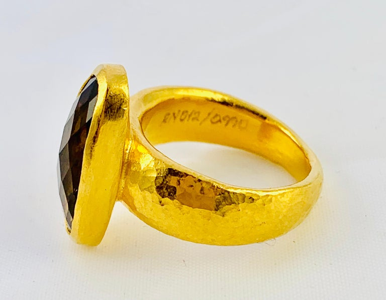 Gorgeous Designer Gurhan Hammered 24K yellow Gold And Smoky Topaz Ring!  It weighs 8.8 grams and is size 5.75. The Topaz measures 3/4 inch by 5.8 inch. Per the Gurhan website: