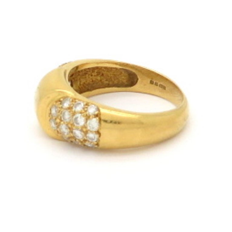 Designer Hermes Paris pave diamond 18K yellow gold ring. Featuring 26 round brilliant cut pave set diamonds weighing approximately 0.50 carats. Diamond grading: color grade: F. Clarity grade: VS1. It is a finger size 5.75 and can be resized.