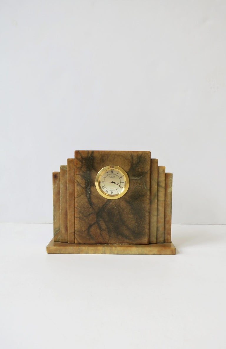 1990s Italian modern Art Deco mantel, desk, or shelf clock in alabaster marble by Oggetti, Italy, circa 1990s. With maker's mark on bottom as show in images #14 and 15. Alabaster marble hues includes: cream, gold, brown/tan and dark green. Gold-tone