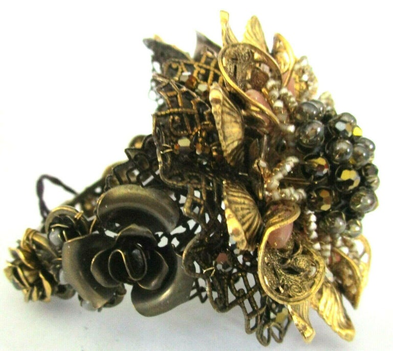 Awesome Miriam Haskell Designer Clamper Bracelet featuring embellished Golden Flowers with crystals, faux pearls and cabochon stones. Antiqued Bronze tone. Bracelet measures 2.5