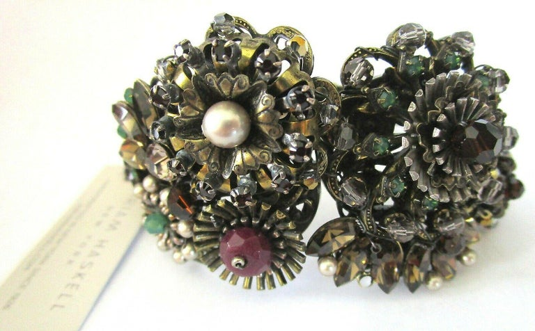 Awesome Miriam Haskell Designer Clamper Bracelet featuring encrusted Flowers with Rhinestones and faux Pearl. Antiqued Bronze tone. Exquisite Signed piece! Never worn.  A Stunning Fashion Statement…A Perfect compliment to your wardrobe!