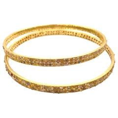 Designer Signed Pair of Fancy Color Raw 7.85 Carat Diamonds 18K Gold Bangles