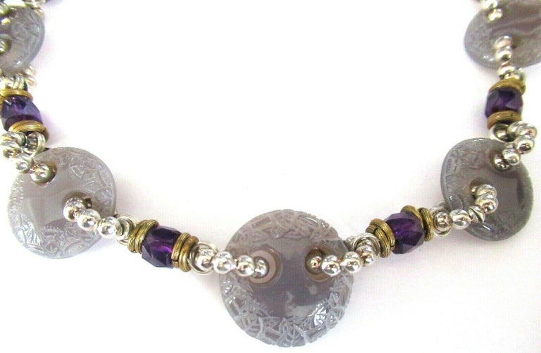 Designer Signed Stephen Dweck Choker Necklace. Genuine Purple Amethyst Crystals inter-spaced with Carved Light Purple Stone Discs and Sterling Silver 925 spacers. Hand crafted Necklace measures approx. 19