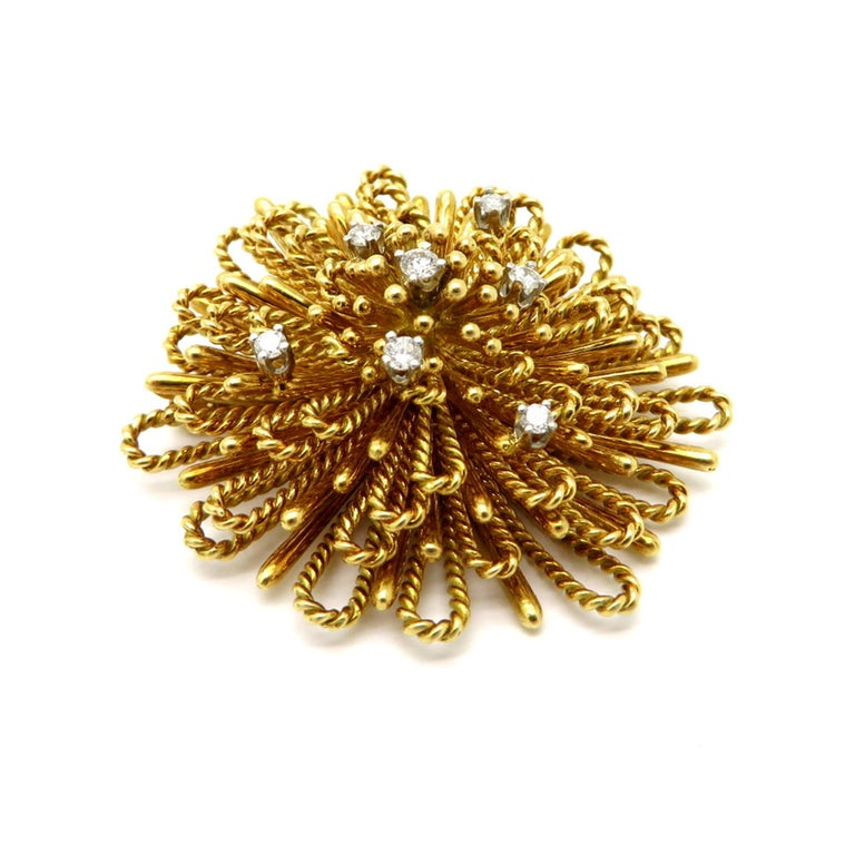 Designer Tiffany & Co. ½ carat spray style diamond 18K yellow gold brooch / pin. Interspersed with seven round brilliant cut diamonds, prong set, weighing a combined total of approximately 0.50 carats. Diamond grading: color grade: F. Clarity grade: