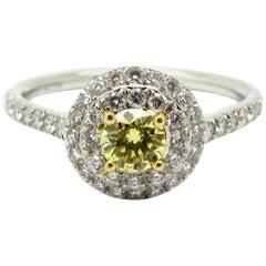 Designer Tiffany & Co. Platinum and 18 Karat Fancy Yellow Diamond Halo Ring