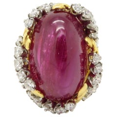 Designer Van Cleef and Arpels Ruby Oval Cabochon and Diamond 18 Karat Gold Ring
