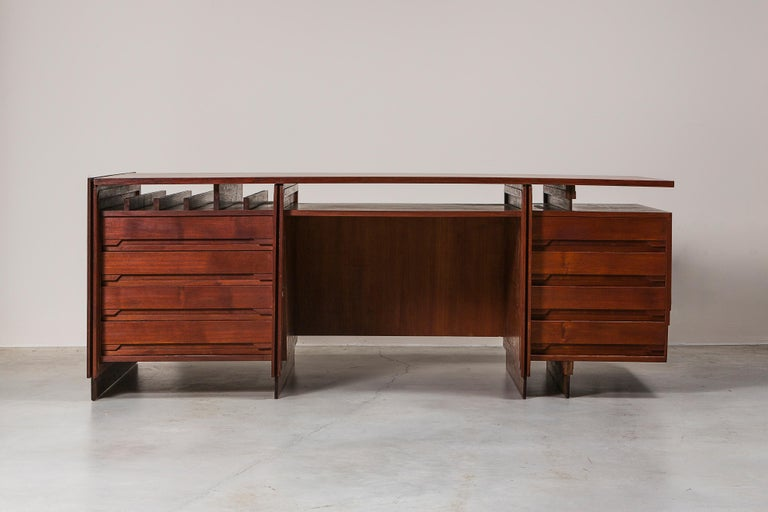 Desk by Giorgio Preti, Italy, 1950s. Designed for then CEO of the Banco di San Geminiano e San Prospero. Wood, brass. Examples provided with original sketches by the architect. Measures: 202 x 100 x H 78 cm. 79.5 x 39.3 x H 30.7 in. Please note: