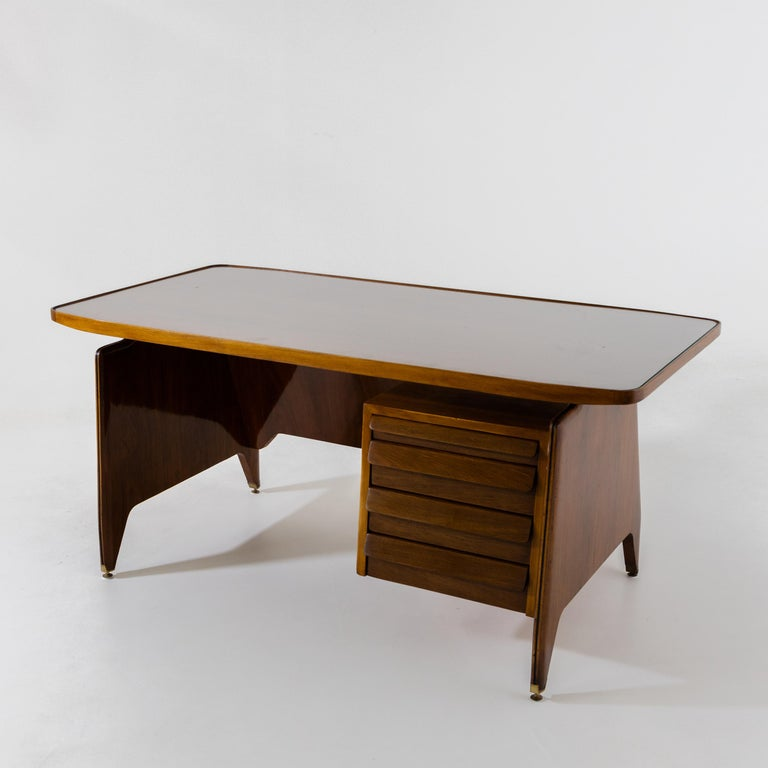 Desk by Vittorio Dassi with side drawers and large slightly convex tabletop.
