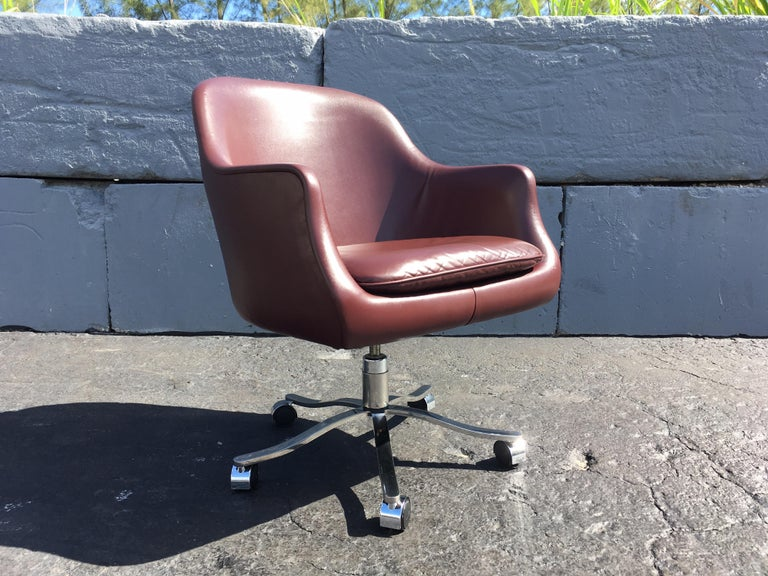 "Desk chair by Nicos Zographos, leather, stainless steel base, tilts, swivels, adjustable seat height is 21.50""-17.50""."