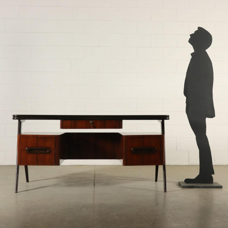 A desk with double lateral drawers. Wood veneer, back-treated glass on the top. Manufactured in Italy, 1950s.