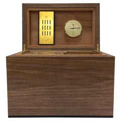 Desktop Humidor in Curly Walnut with Details in Ebony Featuring a Leather Base