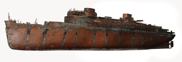 This is a beautiful unique one-of-a-kind copper ship, hand crafted from carved wood, copper and a brass propeller. The details are incredible, from the wire railing to the carved wood doorways and windows. Folded copper staircases and a working