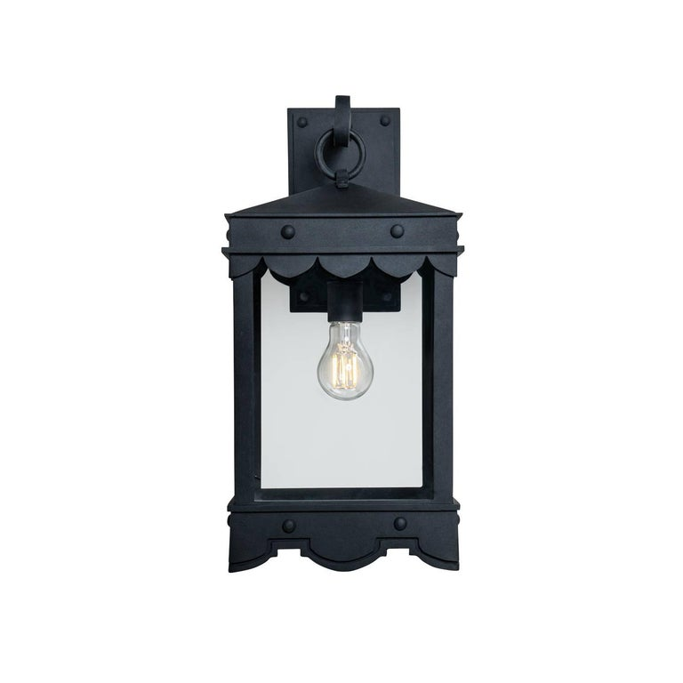 This lantern has Mediterranean style precedence with historic profiles and contemporized geometric lines. A striking fixture during the day but even more so at night when the patterned hem casts intricate shadows.  Our De La Guerra 04 lantern