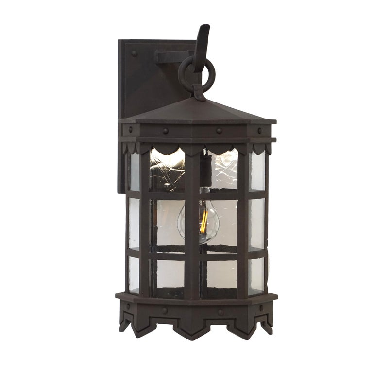 Spanish Colonial Detailed Wrought Iron Outdoor Arm Mount Lantern, DLG Antique Glass Brown Finish For Sale