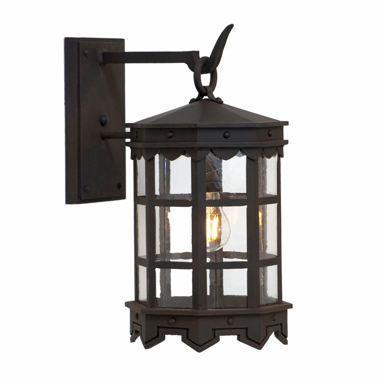 Detailed Wrought Iron Outdoor Arm Mount Lantern, DLG Antique Glass Brown Finish For Sale