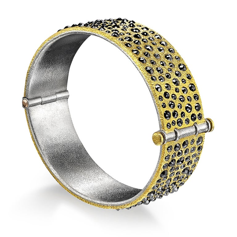 One of a Kind Bracelet hand fabricated by jewelry maker Devta Doolan featuring 10.31 carats of shimmering rose-cut black diamonds set inverted in Devta's signature-finished 22k yellow gold. The finely-textured gold is wrapped around a platinum