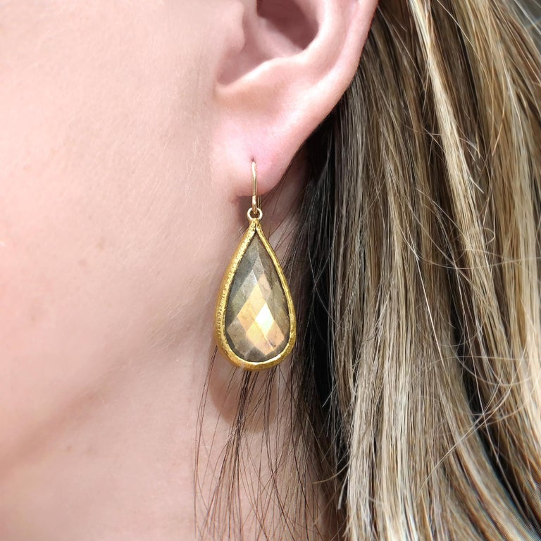 One of a Kind Drop Earrings by master jewelry designer Devta Doolan hand-fabricated in signature-finished 22k yellow gold featuring a matched pair of faceted spectrolite teardrops of extraordinary quality, bezel-set and attached to 18k yellow gold