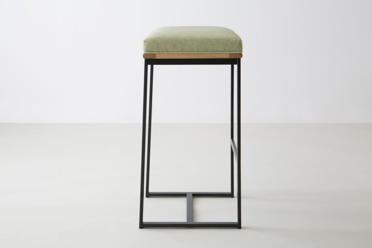 The DGD bar stool finds formality and comfort in the Industrial and organic.   Seat frame shown in white oak and available ash, cherry, maple, or walnut  Powder coated steel frame shown in black/grey and available in any standard RAL colors.