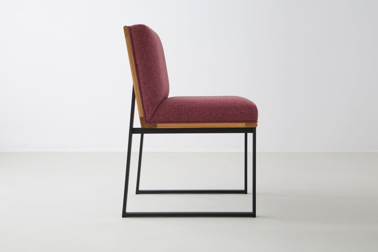 The DGD dining chair finds formality and comfort in the industrial and organic.   Seat frame shown in white oak and available ash, maple, or walnut.  Powder coated steel frame shown in black/grey and available in any standard RAL colors.
