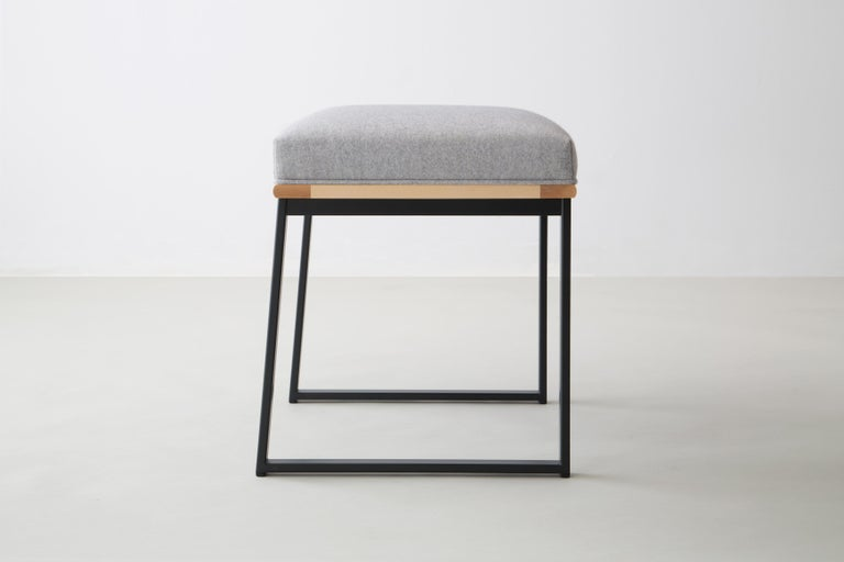 The DGD dining stool finds formality and comfort in the industrial and organic.   Seat frame shown in maple and available ash, cherry, walnut, or white oak  Powder coated steel frame shown in black/grey and available in any standard RAL colors.