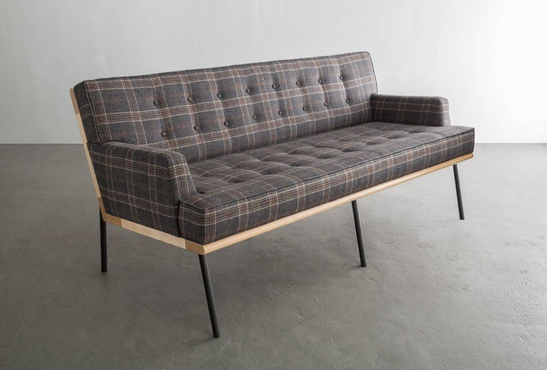 Thoughtful consideration in materials and transitions make this sofa a skillful edit and perfect balance.   Seat frame shown in maple and available in ash or walnut.  Powder coated steel legs shown in black grey and available in standard RAL