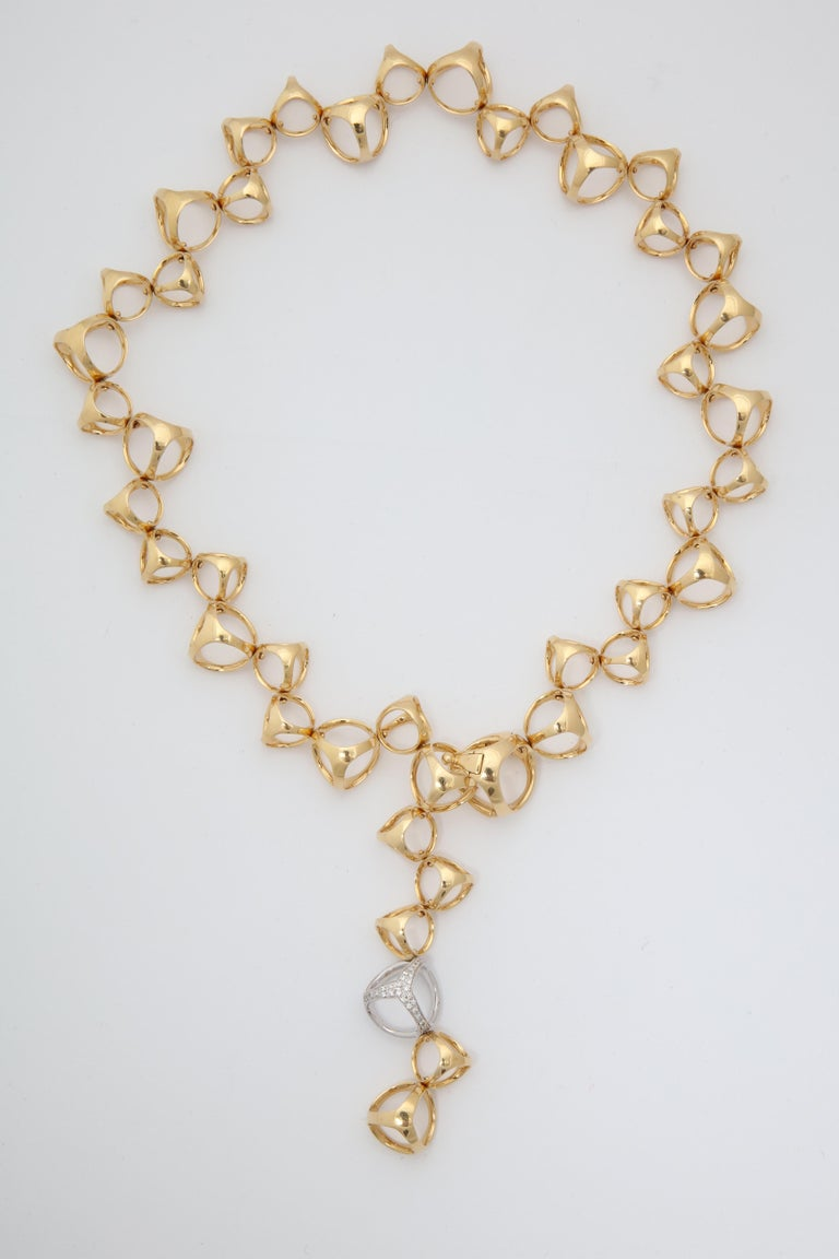 One Ladies 18kt Gold Open Link Necklace Composed Of Numerous Three Dimensional Triadra Style Links One Link In White Gold Set With Approximately .50 Cts Of Diamonds.Signed Di Modolo Milano.Original Retail Price $12,250-