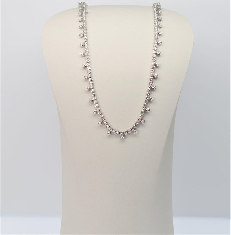 Diamond & 14K White Gold 15-1/2 inch Necklace. One hundred fourteen .05 carat H/VS Diamonds individually set in 14K White Gold, create this timeless, classic collar necklace, great for any occasion. 5.70 cts. Diamonds Total Weight. Total Weight 17.9