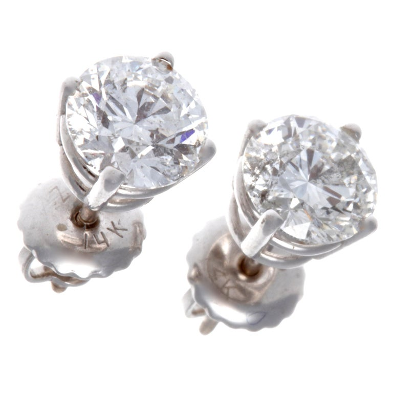 Looking for the perfect studs? These are perfect; bright, very white diamonds, timeless, classic and sparkling. The round cut diamonds weigh a total of 1.60 carats, F-G color, I1 clarity. In 14K white gold.   Flawless Protection Plan -7-day return