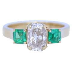 Diamond 1.59 Carat Two Emeralds 18 Karat Yellow Gold Engagement Ring