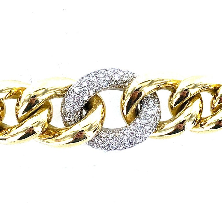 Fine 18 karat yellow gold link bracelet crafted with a center diamond link. The diamond link features 84 round brilliant cut white diamonds that equal approximately 3.00 carat total weight. The diamonds are graded G-H color and VS clarity. The