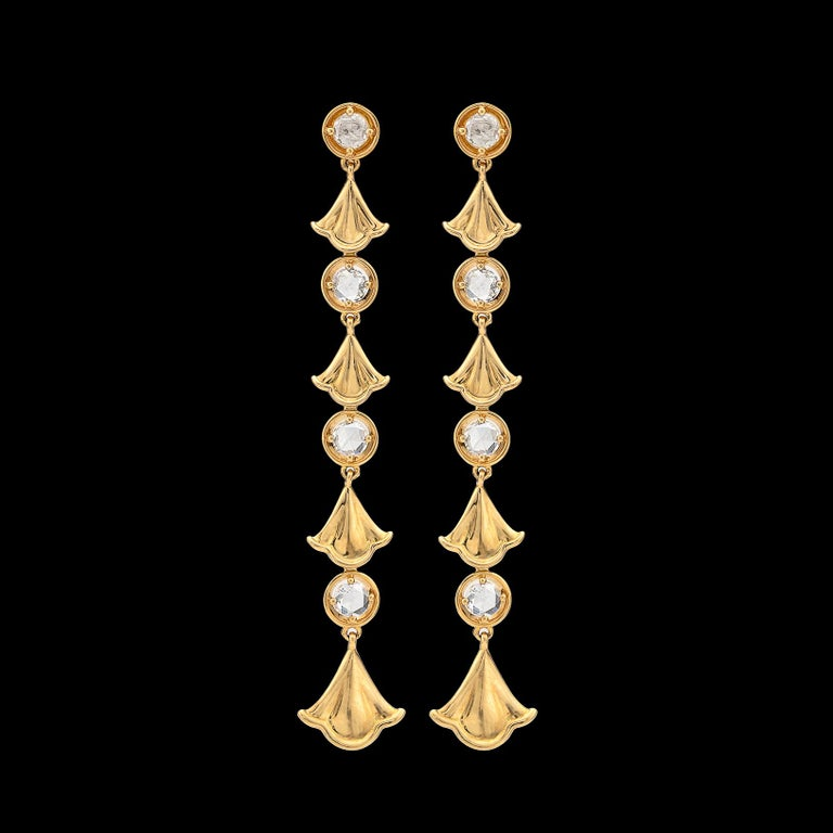 These elegant drop earrings will accent any outfit! By Marina B. of the famed Bulgari family, the 18k gold drops are designed with ginko leaf links alternating with rose-cut diamond links, with a total diamond weight of 0.74 carats. The earrings